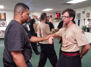 Tai Chi Students practicing Push Hands